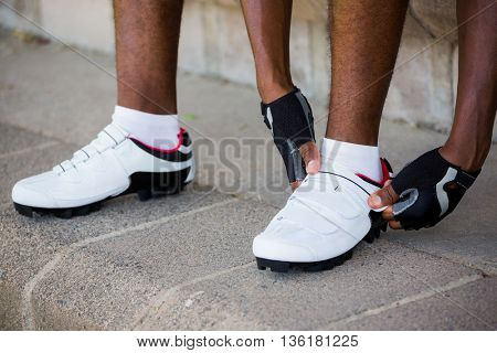 Athlete wearing sports shoes in stadium