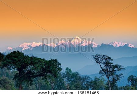 Beautiful view of tress of Silerygaon Village with Kanchenjunga mountain range at the background moring light at Sikkim India