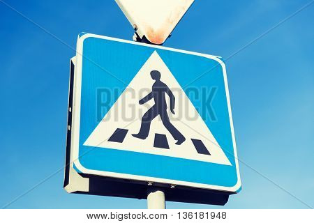 safety, traffic laws and highway code concept - close up of pedestrian crosswalk road sign