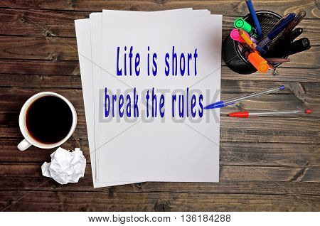 The words Life is short break the rules on paper