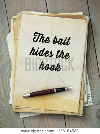 Traditional English proverb.  The bait hides the hook