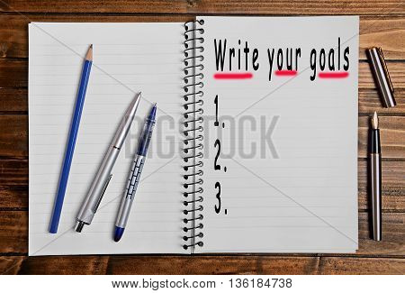 The words Write your goals on notebook
