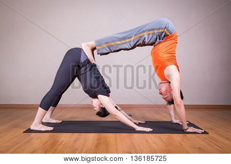Partner Yoga Pose Of Double Downward Dog By A Couple
