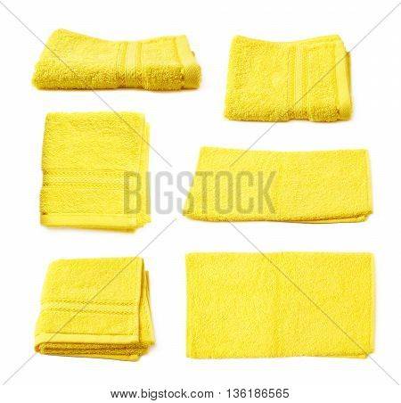 Single yellow terry cloth towel isolated over the white background, set collection of six different foreshortenings