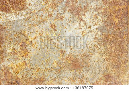 Background rust encrusted steel plate used for a long time.