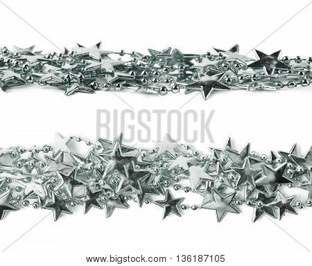 Line of a silver star garland thread isolated over the white background, set of two different foreshortenings