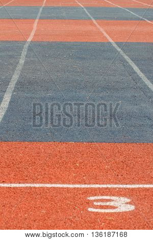 Running track in stadium. Starting of stadium track for a sprint. Fitness, healthy lifestyle concept