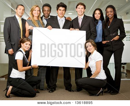 group of business people holding a banner add in an office