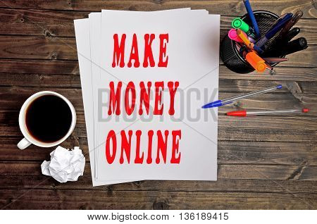 The words Make money online on paper