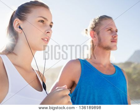Couple running together on the beach