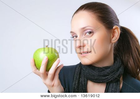 Beautiful Young Woman Showing An Apple