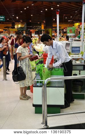 Customer Buying Food At Supermarket