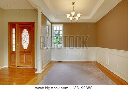 Nice Bright Entry Way To Home With Hardwood Floor