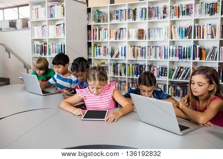 Pupils are using technology in library