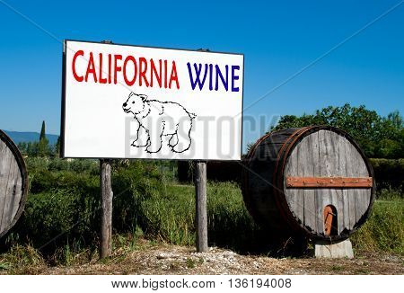 Traditional wooden barrel with a billboard that advertises the sale of wine in the countryside California