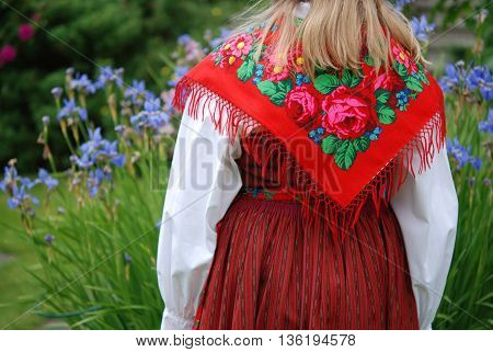 Girl with traditional Swedish costume at Midsummer Eve