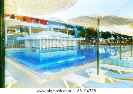 Swimming pool with bar at luxury tropical hotel resort