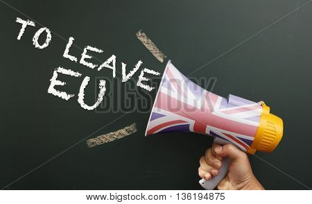megaphone in front chalkboard with text to leave EU