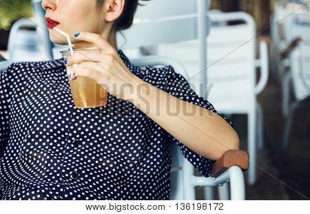 Young Woman Drinking Lemon Tea Concept