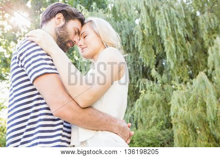 Couple embracing each other in garden
