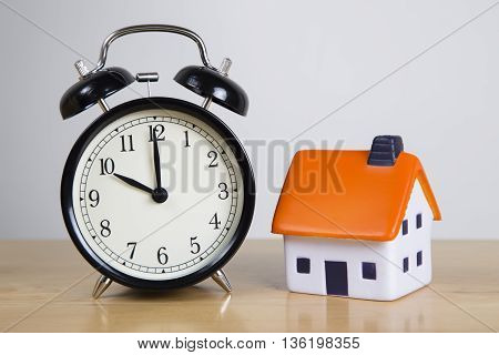 Clock with Foam house - time for a mortgage concept