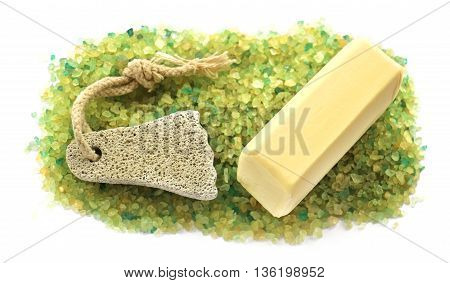 stripe background of large salt crystals colorful yellow green bath with juniper spa pumice in the form of a foot with a soap bar