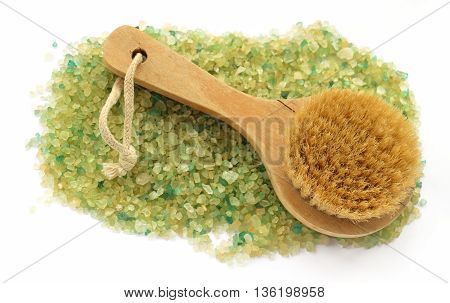 background of large salt crystals colorful yellow green bath with a rope brush massage