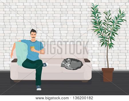 Man with dog pet lying relaxing on the sofa couch and drinking coffee