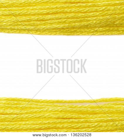 Embroidery thread yarn as a borders of a copyspace composition isolated over the white background