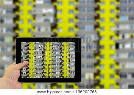 Tablet Photography Concept. Taking Pictures On A Tablet. Acid Yellow And Grey Brick House With Many