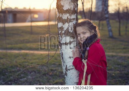 sunset girl portrait close to the birch tree