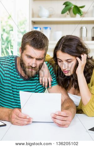 Couple checking their bills at home