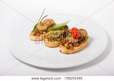 Italian sandwich. Bruschetta on a white plate