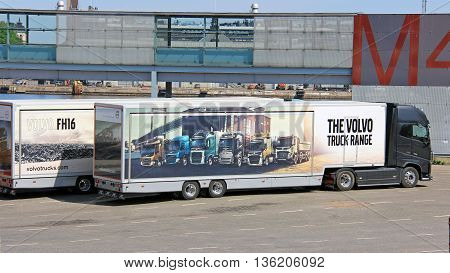 HELSINKI, FINLAND - MAY 24, 2016: Volvo FH16 750 semi displays Volvo truck range pictured on trailer.