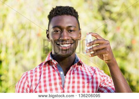 Happy man using an object at park