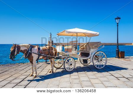 Horse Carriage For Transporting Tourists In Old Port Of Chania On Crete, Greece