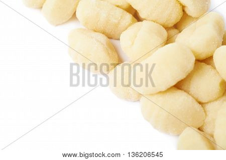 Line of multiple gnocchi dough dumplings isolated over the white background, close-up crop fragment as a copyspace backdrop composition