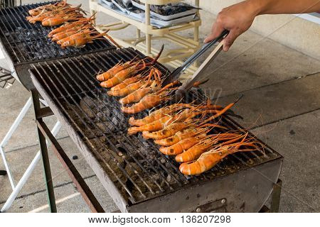 shrimp on the grill with hand, shrimp, grilled,