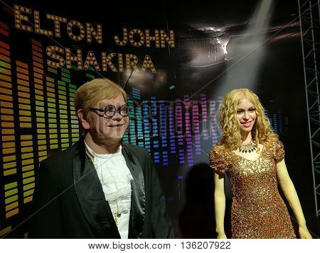 Da Nang, Vietnam - Jun 20, 2016: Elton John and Shakira wax statue on display at Ba Na Hills mountain resort. Sir Elton Hercules John, CBE, is an English pianist, singer-songwriter and composer.