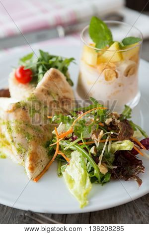 Steamed chicken breast with vegetables salad and nuts