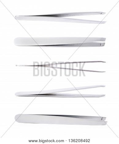 Steel cosmetic tweezers isolated over the white background, set of five different foreshortenings