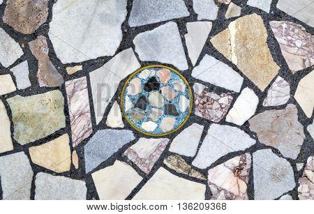 Stylish stone mosaic on the wall close up