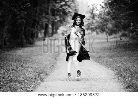 Happy Beautiful Black African American Girl With Hat And Gown Graduates