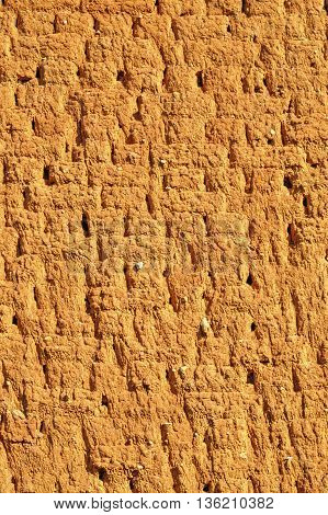 Colorful adobe wall background close up view