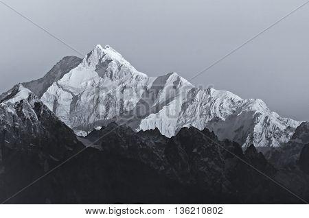 Beautiful first light from sunrise on Mount Kanchenjugha Himalayan mountain range Sikkim India. Black and white stock image.