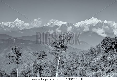 Beautiful view of Silerygaon Village with Kanchenjunga mountain range at the background moring light at Sikkim India. Black and white stock image.