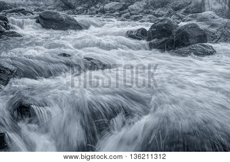 Beautiful Reshi River water flowing through rocksSikkim India. Reshi is one of the most famous rivers of Sikkim flowing through the state and serving water to many local people. Black & White image.