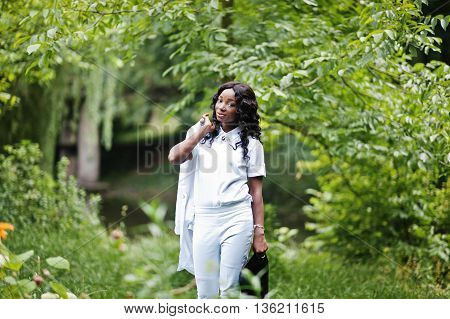 Stylish Black African American Girl Holding Jacket On Her Shoulder At Green Park