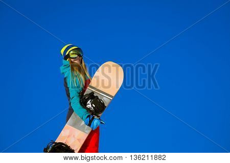 Young woman with snowboard at winter