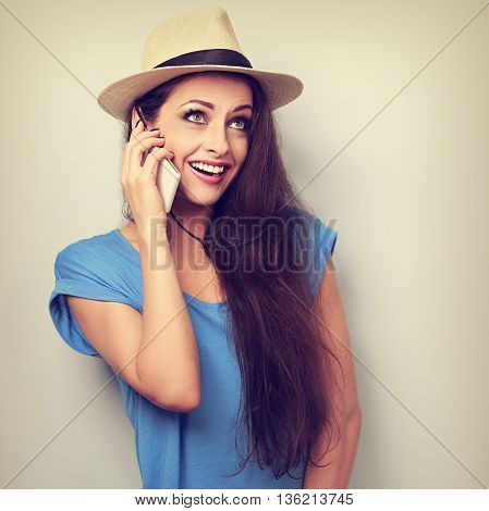 Funny Surprising Woman In Hat Talking On Telephone With Smile. Toned Vintage Portrait